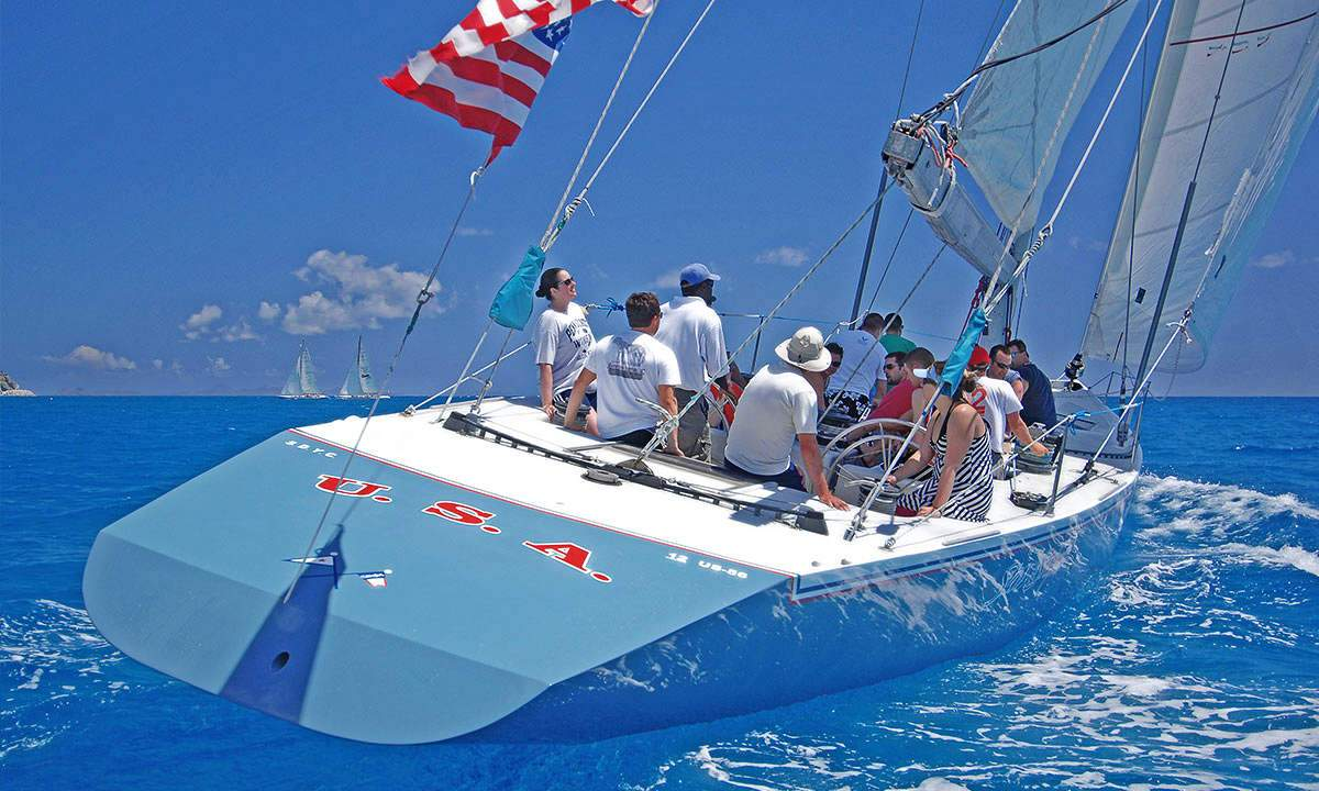 Guests on the America's Cup Yacht Stars & Stripes sailing in Great Bay, St. Maarten